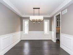 white wainscoting walls in the formal dining room with sw 7018