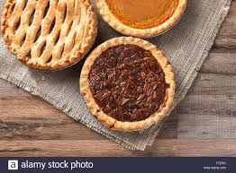 three fresh baked thanksgiving pies a pecan pie apple pie and