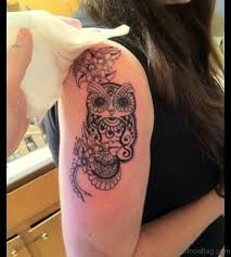 40 speechless owl tattoo on shoulder