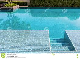 swimming pool with clear blue water stock photo image 74597040
