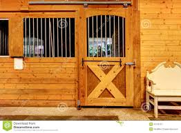 interior of shed with horse stables royalty free stock