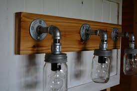 the vanity mason jar light is designed to give a blend of the rustic and