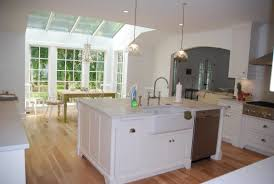 kitchen island with dishwasher and sink white cabinets granite