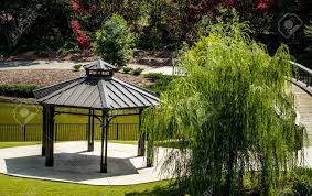 willow gazebo gazebo and weeping willow tree beside pond with trees and flowers