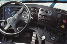 dashboard inside a semi truck gauges and instruments