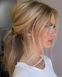 ponytail bump 30 eye catching ways to style curly and wavy ponytails ponytail