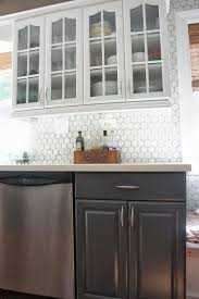 remodelaholic gray and white kitchen makeover with hexagon tile two tone gray and white kitchen makeover lovelee homemaker featured on remodelaholic com