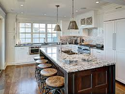 the open floor plan transitioning a kitchen and dining room to