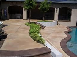 excellent use of stained concrete for this pool deck and patio