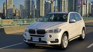 Bmw X5 99 - in pictures bmw x5 a big truck with small car handling the
