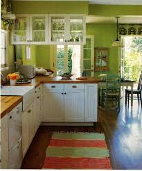 green kitchen wall color with white cabinets and butcher block