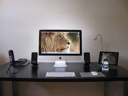 white minimalist corner computer desk with keyboard tray imac and
