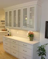 shallow buffet built of white shaker cabinets with textured glass