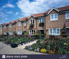 Modern Row House by Row Of Modern Brick Terraced Houses With Front Garden South Of
