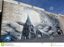 graffiti artist paint a mural on a wall editorial stock image murals in christchurch new zealand stock photography