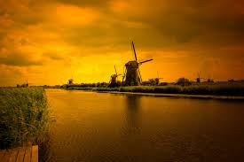 kinderdijk sunset wallpapers sunset by the river by flowerroad on deviantart