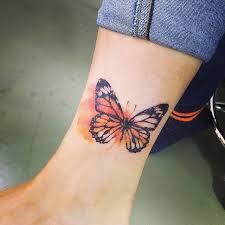 style butterfly tattoo on the ankle