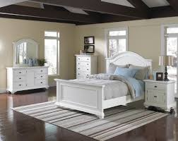 pure white queen bedroom set with brown striped rug on laminate