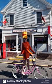 a drag queen on a pink bicycle in provincetown on cape cod stock