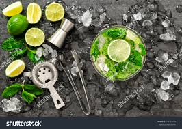 green cocktail black background cocktail juice lime mint ice bar stock photo 519701998 shutterstock