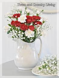 pitcher of roses tips for arranging fresh flowers town country living