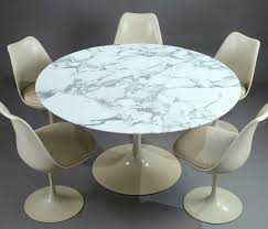 tulip dining table and set of five tulip chairs by eero saarinen