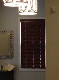 dark brown wooden blinds in the lobby of an office jpg