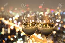 night view of the city reflected in the glass of wine stock photo