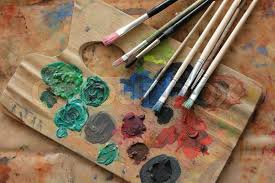 paint brushes and color on the palette background stock photo