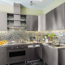 white kitchen cabinets with stainless steel backsplash 84 stainless steel countertop ideas photos pros cons