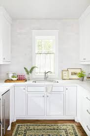 kitchen white shaker kitchen cabinets with black countertops