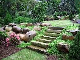 flagstone slab steps boulders and groundcover traditional