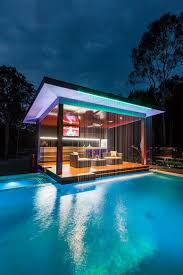 outdoors modern white pool house with modern view and small pool