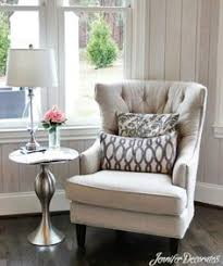 living room accent chair this living room is fierce love these chairs and the pillows check