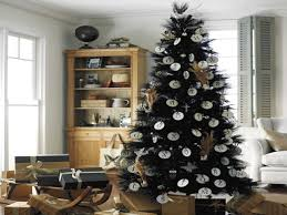 white christmas tree with black decorations christmas lights