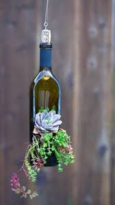 succulent planter turn wine bottles into gorgeous succulent planters diy projects