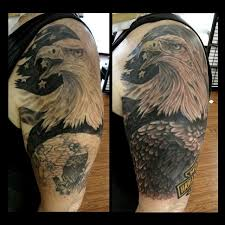 this is a coverup tattoo it u0027s a harley davidson eagle arm piece