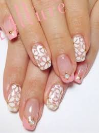 classic french manicure with flower detail on the ring finger