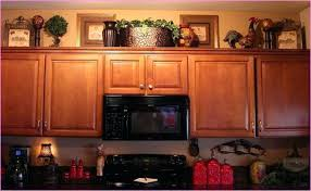 creative ideas for top of kitchen cabinets top of the cabinet
