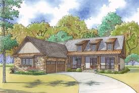 courtyard garage house plans craftsman house plan with courtyard garage and rustic appeal