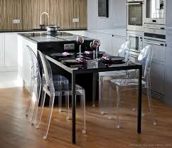 Modern Luxury Kitchen With Black Island Table And Plexiglass - Black kitchen island table
