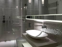 bathroom vessel sink open cabinets a wall mount toilet gray