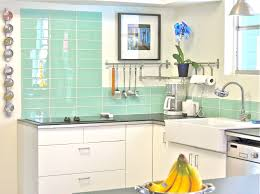 interior chic white kitchen with herringbone backsplash and