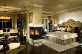 luxury master bedroom with classic central fireplace ideas mounted