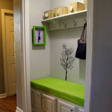 bathroom cabinet with built in laundry her closet to landing zone hall closet mudroom and hall
