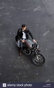 black biker style boots top view of a handsome rider man in black biker jacket checkered
