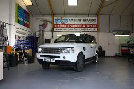 white wrapped range rover active rentals v8 range rover sport white wrap ambient graphics