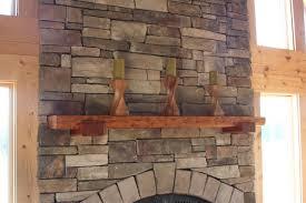 log home progress fireplace mantle made of reclaimed hemlock wood