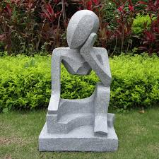white modern garden ornaments resembling a princess who was muse