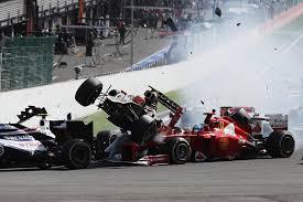 romain grosjean and fernando alonso crash at the start of the 2012 belgian f1 grand prix jpg